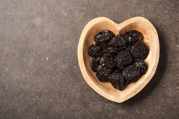 Prunes in heart shaped bowl