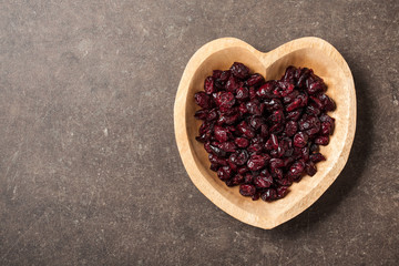 Dried cranberries in heart shaped bowl