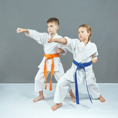 Children are training blow the hand on a gray background