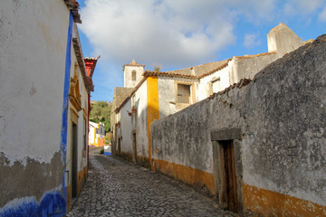 one of the narrow, charming street in Obidos, Portugal