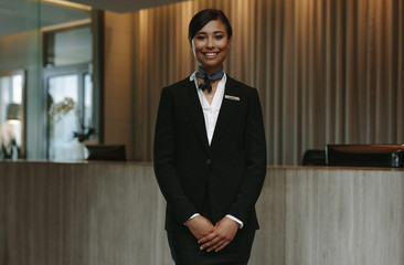 Beautiful concierge waiting for welcoming guests