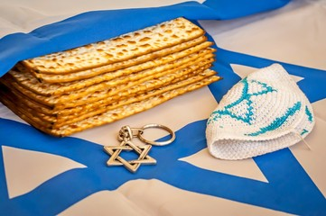 Two pieces of matzah, traditional Jewish unleavened bread, that make up a David Star on a plate with a vintage background. Pesach concept, Jewish Passover stock image.