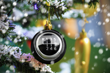 Christmas bauble with car gearshift symbol