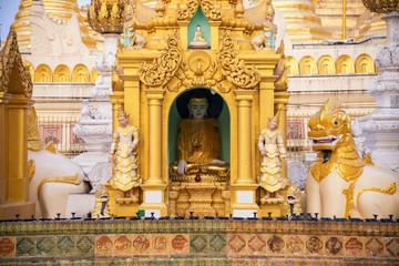golden buddha statue at shwedagon golden pagoda in Yangon , Myanmar