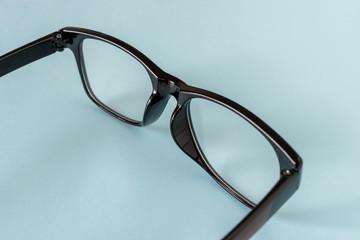 Black Eye Glasses on blue background.