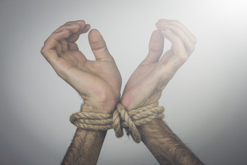 a young man tied hands