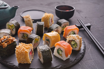 Set of sushi maki and rolls on gray background