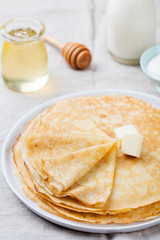 Thin crepes or pancakes with butter and sour cream
