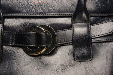 seams on leather hand bag