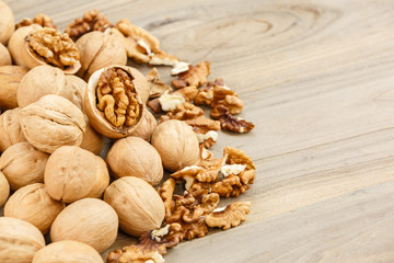 walnuts on a rough wooden background