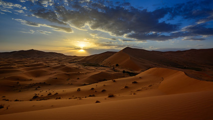 sunset in the Sahara desert, Erg Chebi dunes. Merzouga, Morocco