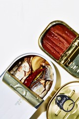 Overhead view of open tin of sardines and mackerel