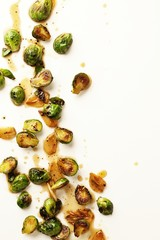 Roasted Brussels sprouts on white background