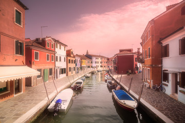 Venecia canal with boats and gondolas, Italy
