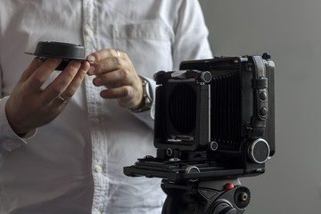 Retro photographer using old camera