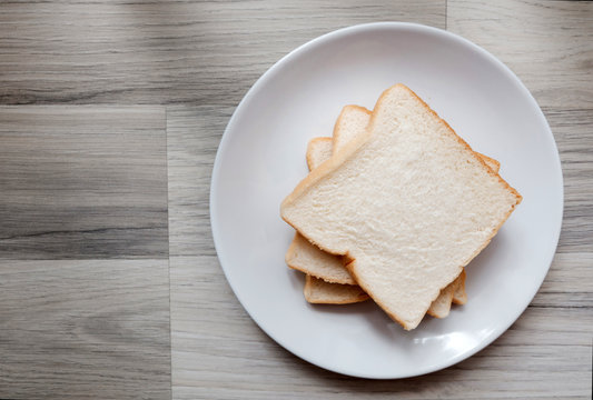Toasted 3 slice of bread on white plate