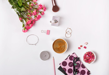 Roses, coffe and small stylush feminine accessories on the white backround