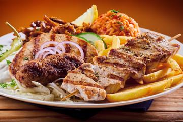Greek grill plate with souvlaki and souzuki steak