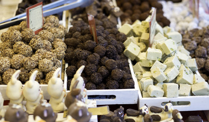 Various tasty sweets on food market. Chocolate bit sized for sale in local chocolate store. selective focus