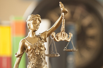 justice symbol  woman holding scale