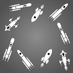 A set of painted spaceships flying in different directions on a gray background