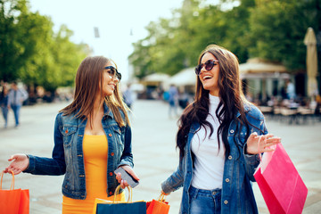 Two young women in shopping in the city down town
