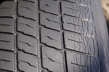 An old worn-out tire close, background