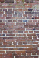 Vertical image of Old Fernch Brick wall, wallpaper pattern, background texture