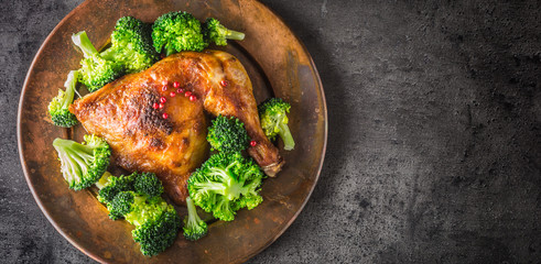 Roast chicken Leg. Chicken roasted leg with broccoli on concrete table