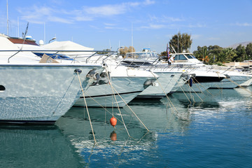 Summer time beautiful yachts moored in Glyfada port, Athens, Greece.