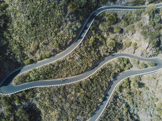 Aerial view of cyclists pedaling on winding road, Tenerife, Canary Islands, Spain