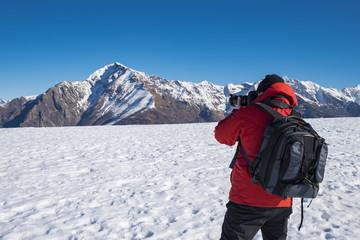Fotografo tra le alpi