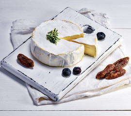 Camembert cheese and pieces of smoked sausage