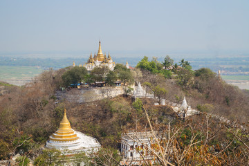 Golden pagoda and stupas on the Sagaing Hill in Mandalay, Myanmar (Burma) on a sunny day.
