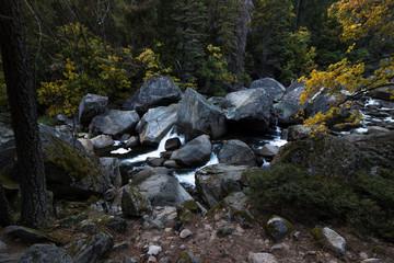 Water flowing over granite rocks in Yosemite Valley, California.