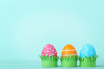 Colorful easter eggs on mint background
