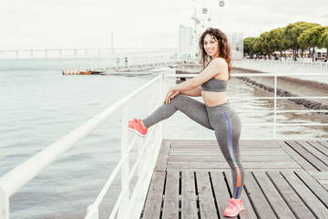 Positive Sporty Woman Exercising on City Quay