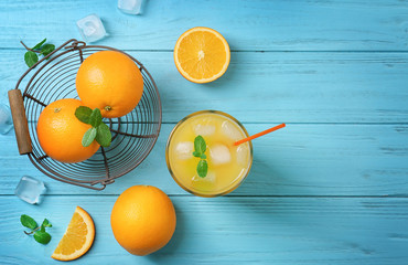 Beautiful composition with fresh orange juice on wooden table, top view