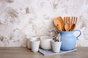 Set of cooking utensils and dishware on table