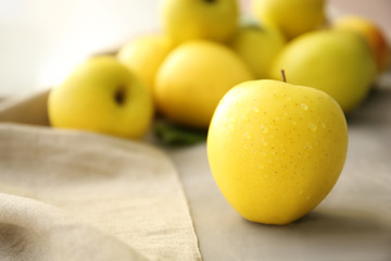 Ripe yellow apple on table, closeup