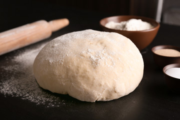 Raw dough on kitchen table