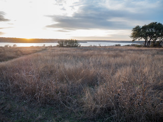 Path to the Lake with Tall GRass in the Foreground and sunset in the background