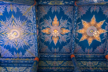 Beautiful wall and ceiling paintings in thai fine art pattern at Wat Rong Suea Ten Temple, locate at Chiang Rai province, northern part of Thailand.