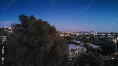 Fotobehang Aerial city view of Hollywood at dusk, revealing downtown Los Angeles skyline on horizon. 4K UHD.
