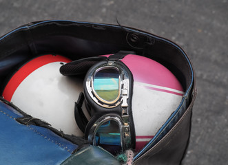 Old-style motorcycle helmet in the end motorcycle storage bag. Close up image.