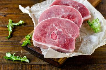 Raw turkey steak on a wooden cutting board. Healthy eating. Diet.