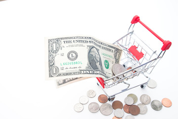 Currency, Paper currency and coins in shopping cart, Financial and shopping concept