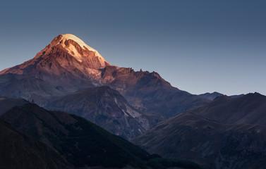 sunrise over Mount Kazbek in greater caucasus mountains