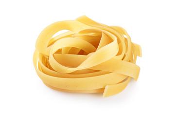 Raw tagliatelle pasta isolated on white background.