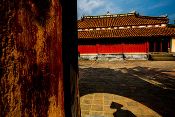 A shadow of a tourist wearing the Vietnamese traditional conical hat at Minh Mang's tomb in Hue, Vietnam